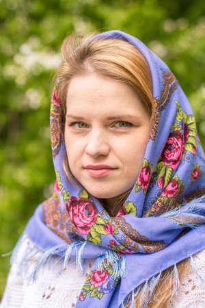 eyeing: Beautiful woman in a blue shawl Stock Photo