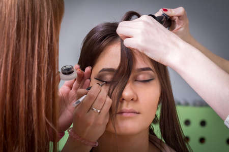 perming: Stylists doing hair and makeup