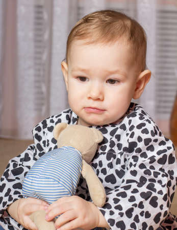 soft toy: Little girl with a soft toy Stock Photo