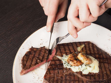 Juicy delicious sirloin steak with grilled shrimps