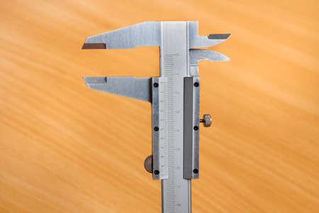 vernier caliper: Vernier calipers on cinnamon background