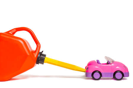 jesting: Refueling toy car with plastic gas tank Stock Photo