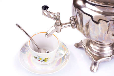 Traditional russian tea kettle - samovar and teacup photo