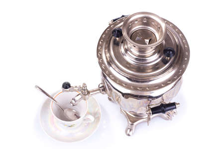 Traditional russian tea kettle - samovar and teacup  Upper view  photo