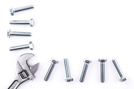 Screws and spanner isolated on white background photo
