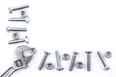 Screws, nuts and spanner isolated on white background photo
