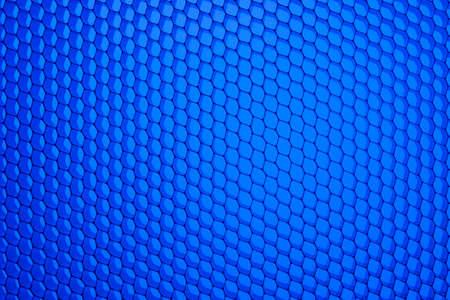 aluminum background: Honeycomb grid against blue background