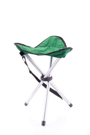 portative: Three-legged tourist portable chair isolated on white