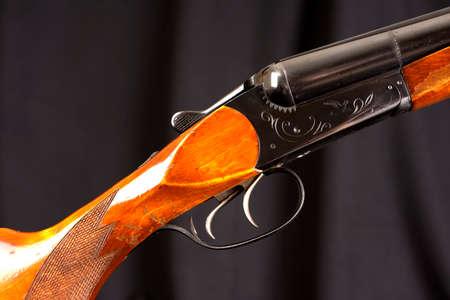 vintage rifle: Closeup of vintage hunting rifle against black Stock Photo