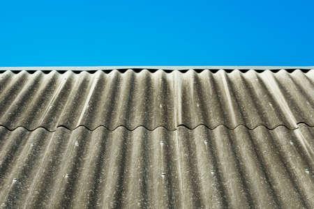 slate roof: Slate roof over blue sky