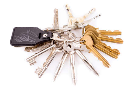 keychain: Bunch of keys and leather keychain on white Stock Photo