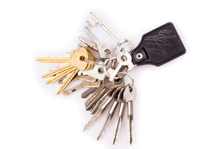 Bunch of keys and leather keychain on white Standard-Bild