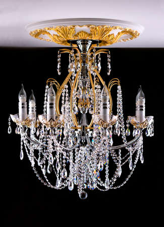 electrolier: Classical style chandelier on ceiling over black background Stock Photo