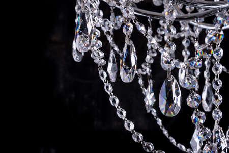 Crystal chandelier details on black background