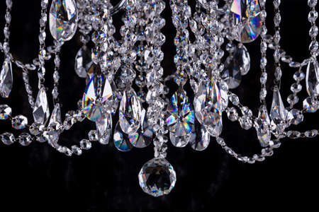 Close-up of crystal chandelier details on black background