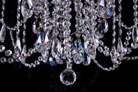 Close-up of crystal chandelier details on black background