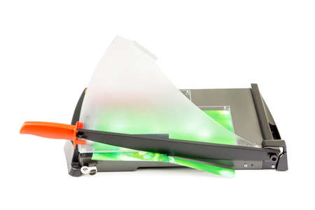 trimmer: Cutting paper with trimmer on white background