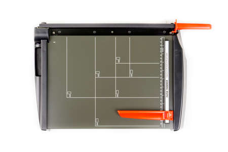 guillotine: Paper trimmer on white background. Top view. Stock Photo
