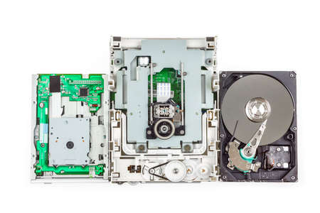 dvd rom: Three types of a computer storage devices: floppy, cd-rom and hard drive,  white isolated Stock Photo