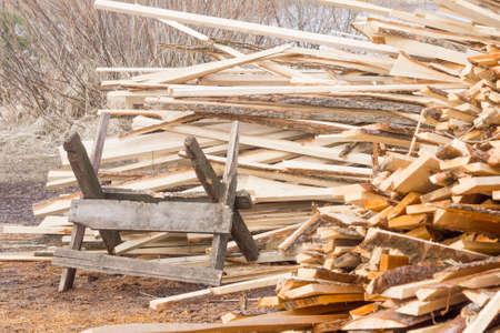 Sawbuck on pile of firewood background Stock Photo