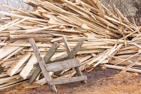Sawbuck on pile of firewood background Zdjęcie Seryjne