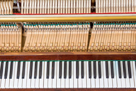upright piano: Keyboard and mechanics details of an upright piano Stock Photo