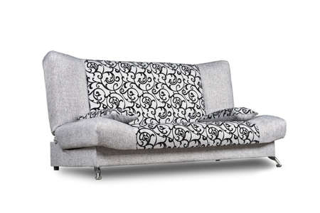 Modern sofa of light grey patterned fabric isolated on white, low-angle shot