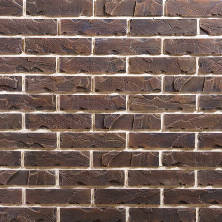 Dark brown brick seamless repeating wallpaper background pattern Zdjęcie Seryjne