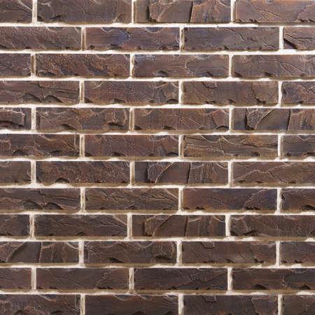 Dark brown brick seamless repeating wallpaper background pattern Standard-Bild