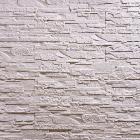 White stone seamless repeating wallpaper background pattern