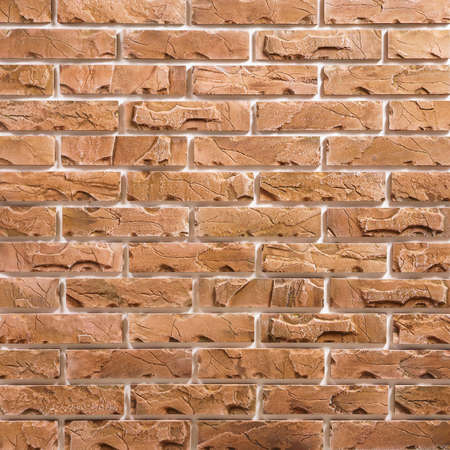Light-brown brick seamless repeating wallpaper background pattern