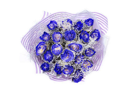 Bouquet of twenty one blue roses from top, silver coloring on the petals, isolated on white background