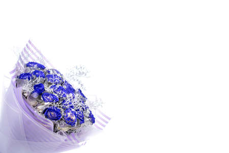 Bouquet of blue roses, corner composition with copyspace, on white background
