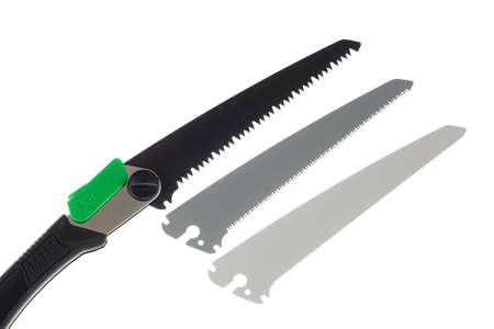 Folding handsaw and replaceable blades isolated on white