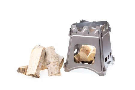 Folding wood stove designed for cooking outdoors using small firewood as fuel 写真素材 - 130834162