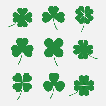 Clover leaves set isolated on white background. Silhouettes of four and three leaf clover. Lucky leaf clover in flat style. 矢量图像