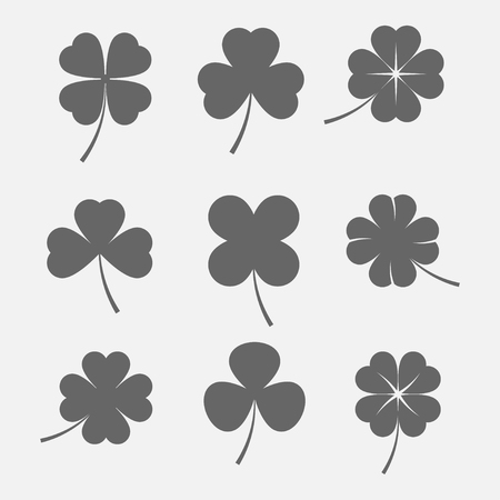 set icons of three and four leaf clover. Irish symbol of luck and St Patrick's Day. Dark silhouettes of clover leaves in a flat style. Illustration