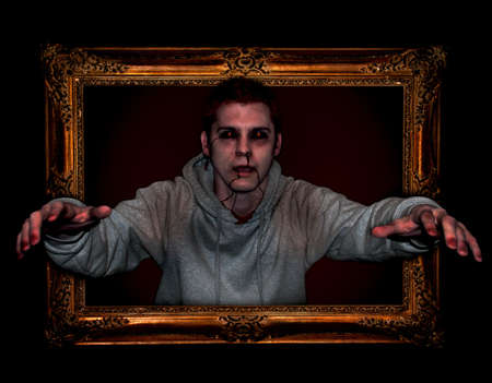 Zombie in Picture Frame. View close-up for high detail. Stock Photo
