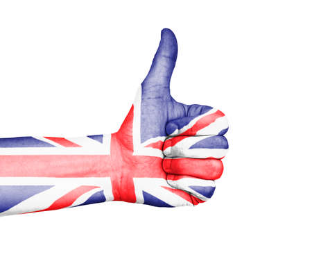 Male hand giving a thumbs up approval, painted with the British Union Flag. Isolated on a white background with clipping path. Great for a British concept. photo