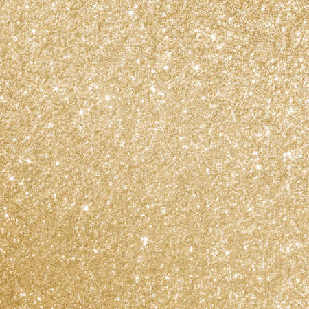 twinkles: Glittery gold background texture perfect for Luxury, fashion or Christmas and holiday season designs.