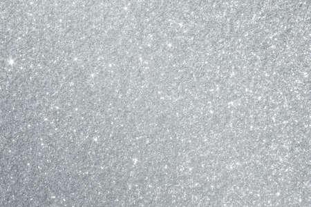 Glanzende zilveren achtergrondtextuur perfect voor Luxe, mode of Kerstmis en vakantieseizoen ontwerpen.