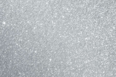 silver: Glittery silver background texture perfect for Luxury, fashion or Christmas and holiday season designs.