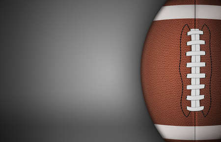 sideline: American football ball on gray background. with lots of copy space. Stock Photo