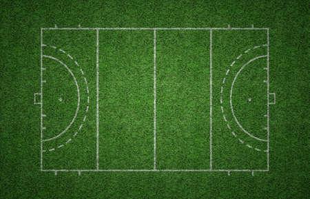 hockey cesped: Campo de césped verde de hockey sobre césped con líneas blancas que delimitan el terreno de juego.