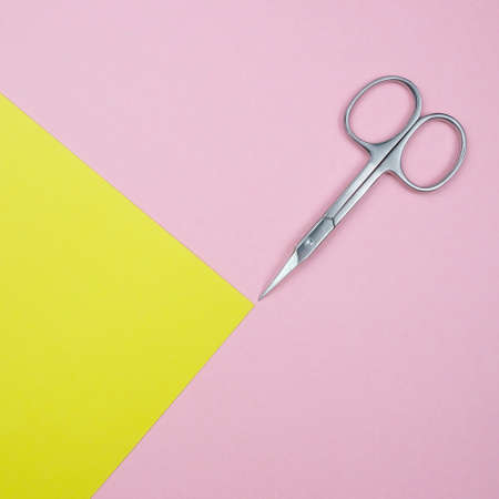Square Composition With Manicure Scissors For Nails On The Geometric Pastel Pink And Yellow Colors Background Minimal Style Flat Lay Copy Space Imagens - 107318678