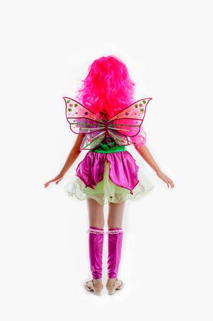 peruke: young girl in colorful as winx carnival costume, pink periwig peruke