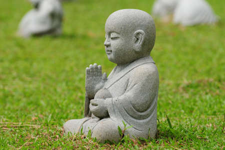 Cute Young Buddha In Meditating Pose Stock Photo