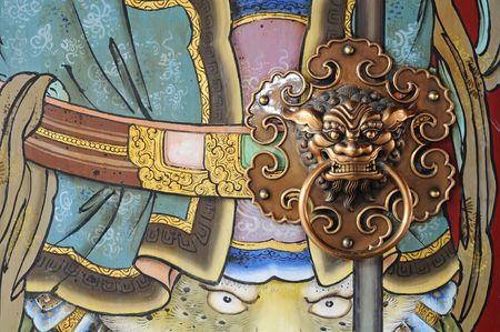 Door God Of Chinese Temple And Door Handle Stock Photo - 6050095