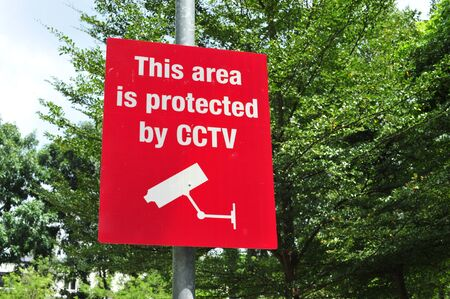 close circuit camera: Red CCTV Sign In Protected Compound
