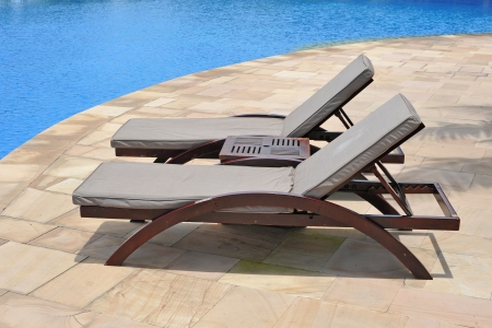 furniture detail: Beach Bench At A Swimming Pool